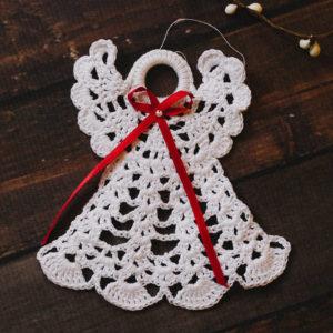 a crocheted angel ornament